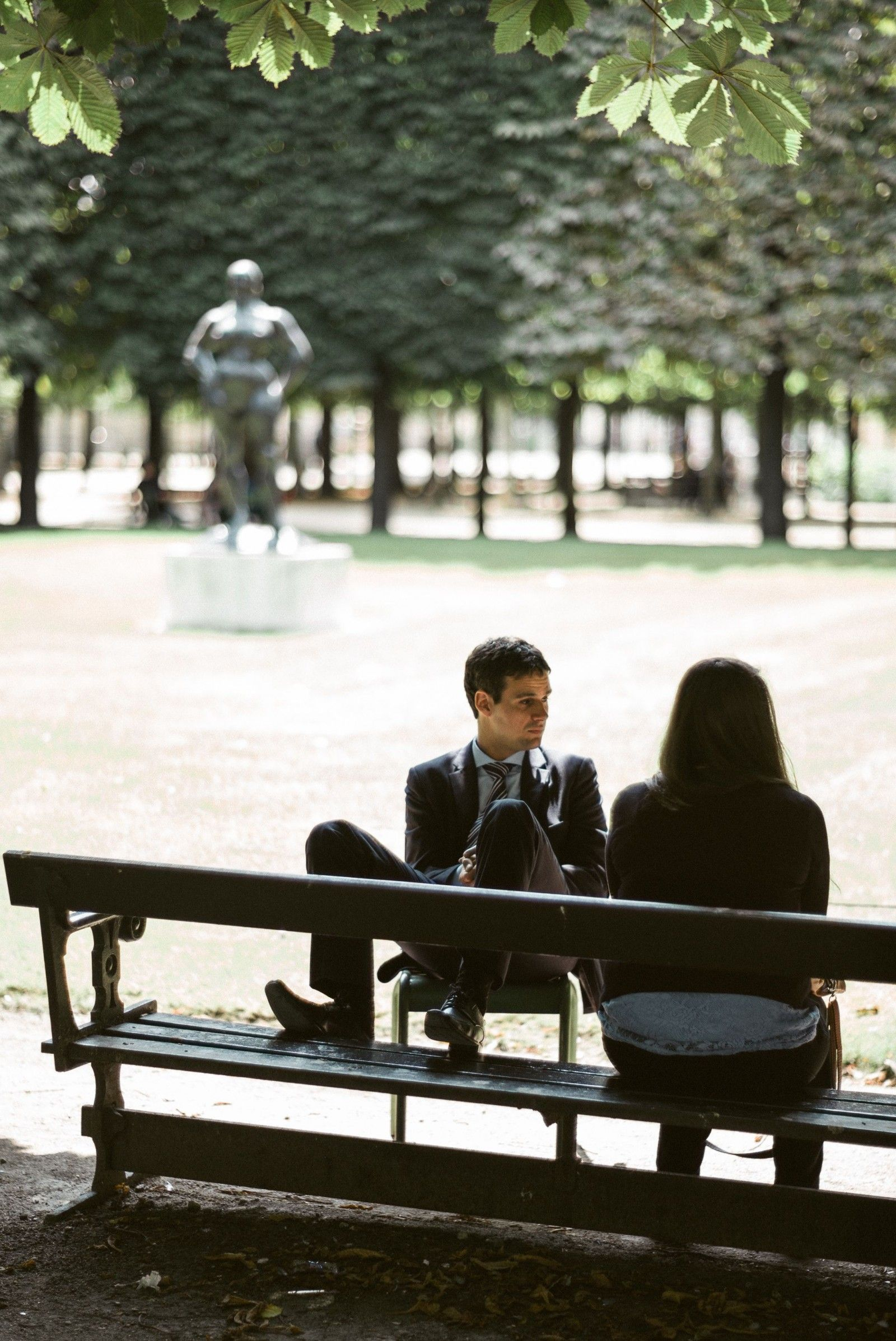 A young man together with a young woman in the park.
